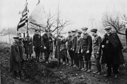 Marshall Ferdinand Foch, Commander in Chief of all Allied armies in France; Mrs. Alexander McEwen, Seattle Garden Club; and Brigadier General Alexander, Camp Lewis - planting a tree along Des Moines Memorial Drive - photo courtesy City of Burien
